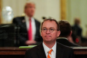 White House Acting Chief of Staff Mick Mulvaney watches as President Donald Trump welcomes the 2018 College Football Playoff National Champion Clemson Tigers in the East Room of the White House in Washington, D.C. Photo by Joshua Roberts/Reuters