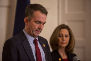 Virginia Gov. Ralph Northam, accompanied by his wife Pamela Northam announces he will not resign during a news conference in Richmond, Virginia. Photo by Jay Paul/Reuters