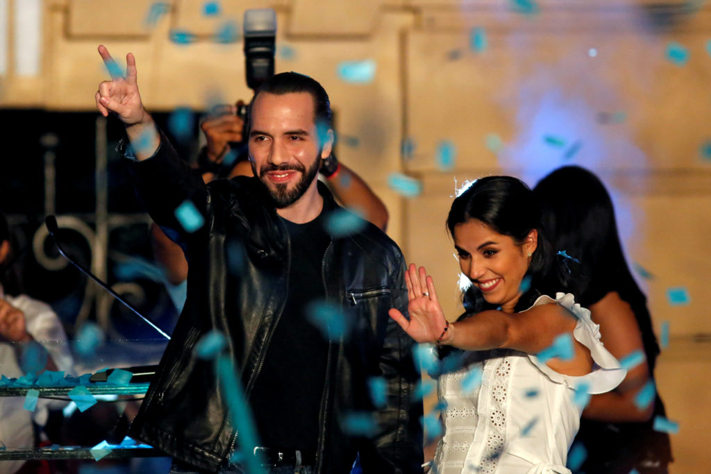 Presidential candidate Nayib Bukele of the Great National Alliance (GANA) and his wife Gabriela de Bukele gesture as they ...