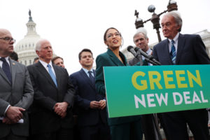 "Rep. Alexandria Ocasio-Cortez (D-N.Y.) and Sen. Ed Markey (D-Mass.) hold a news conference for their proposed ""Green New Deal"" to achieve net-zero greenhouse gas emissions in 10 years, at the U.S. Capitol in Washington, D.C. Photo by Jonathan Ernst/Reuters"