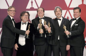 """Green Book"" producers Jim Burke, Charles Wessler, Nick Vallelonga, Peter Farrelly and Brian Hayes Currie pose backstage with their Best Picture statues at the 91st Academy Awards. Photo by Mike Segar/Reuters"