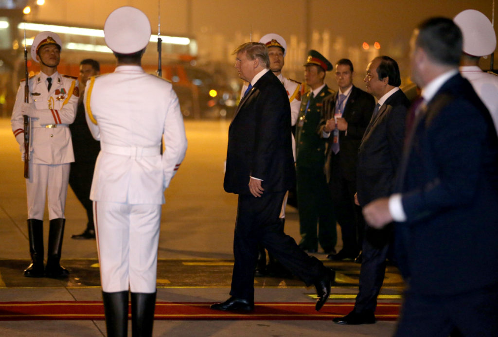 President Donald Trump arrives at Noi Bai International Airport for a second summit with North Korea's leader Kim Jong Un in Hanoi, Vietnam. Photo by Leah Millis/Reuters