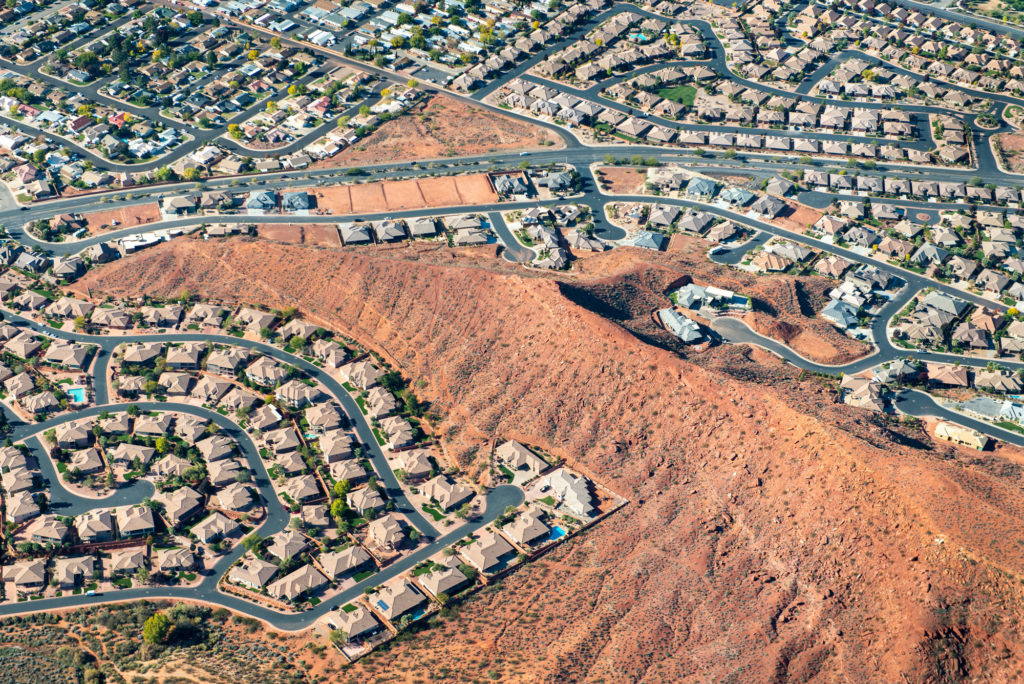 St. George, Utah has been booming, with subdivisions and golf courses pushing into the desert. Support for aerial photographs provided by Lighthawk.