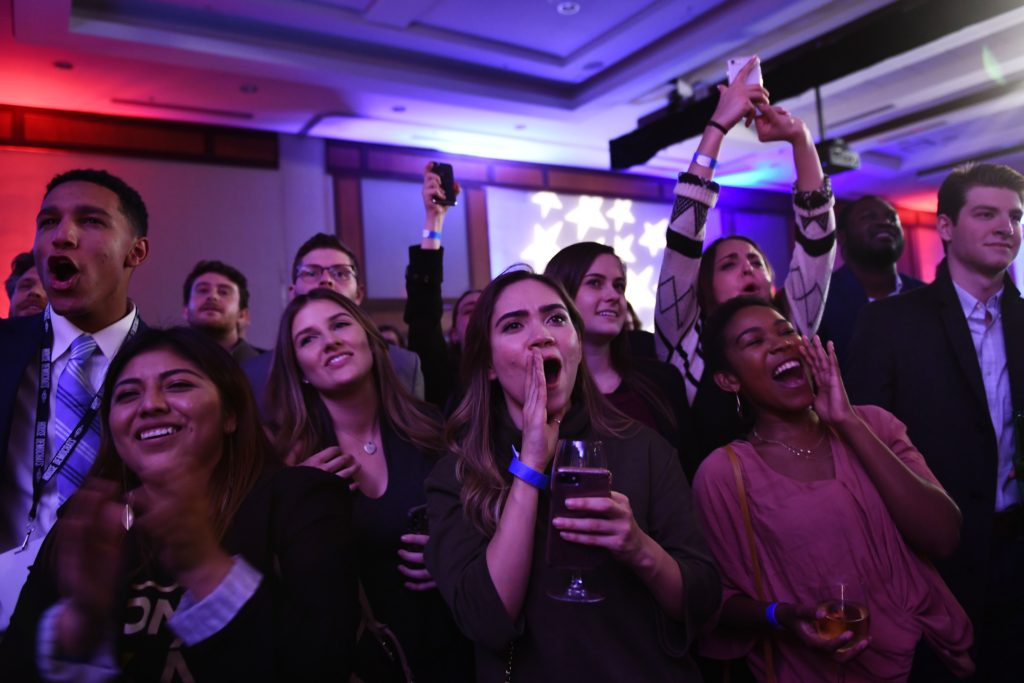 People cheer while watching election results during a midterm election night party hosted by the Democratic Congressional Campaign Committee November 6, 2018 in Washington, DC. (Photo by Brendan Smialowski / AFP) (Photo credit should read BRENDAN SMIALOWSKI/AFP/Getty Images)