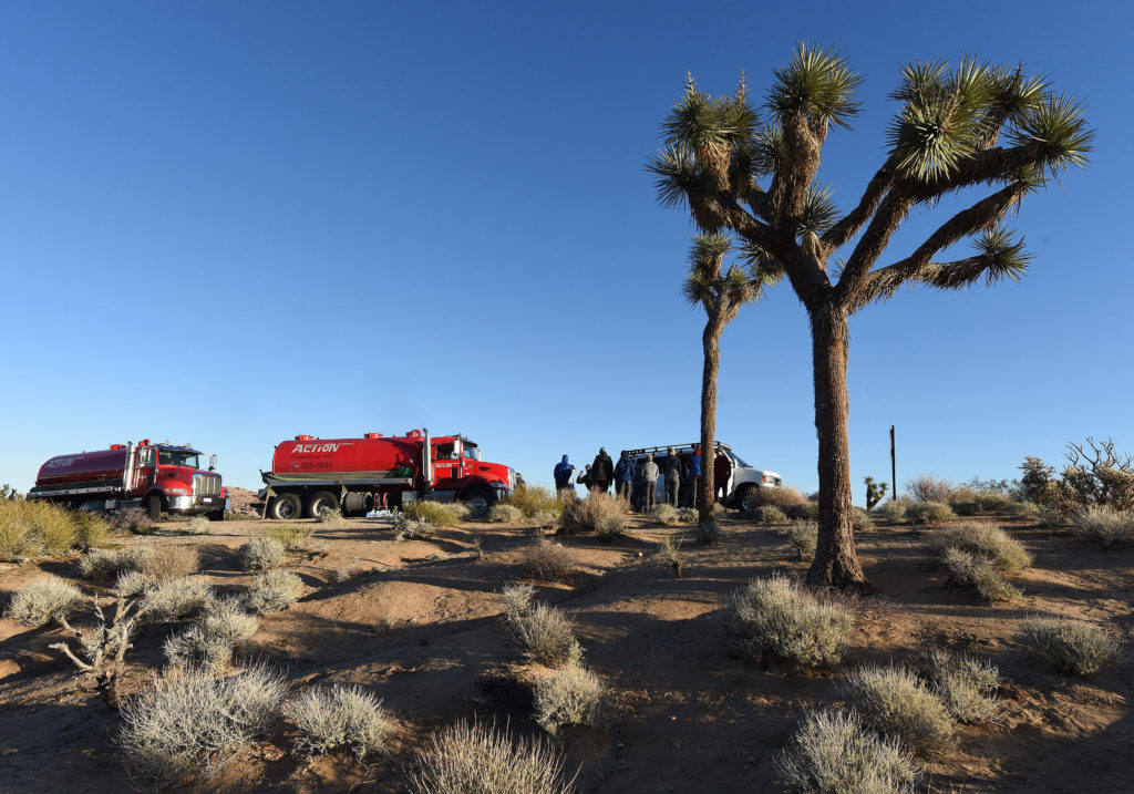 Volunteers, along with two sewage pumping trucks, wait to head into Joshua Tree National Park at the west entrance to help with clean up Thursday morning. Despite the partial federal shutdown Joshua Tree National Park remained open Thursday, January 10, 2019. The park has minimal staffing and campgrounds are now open. There is no park entry fee at the moment. (Photo by Will Lester/MediaNews Group/Inland Valley Daily Bulletin via Getty Images).