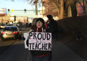 Jessica Wolf, a teacher at Colfax Elementary, leads other educators and supporters in a chant outside Colfax Elementary School during the second day of a strike for Denver Public School teachers on February 12, 2019 in Denver, Colorado. (Photo by RJ Sangosti/MediaNews Group/The Denver Post via Getty Images)