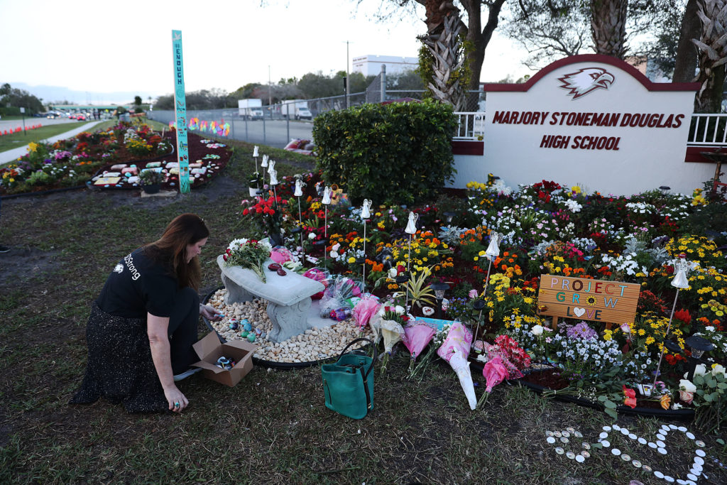 PARKLAND, FLORIDA - FEBRUARY 14: Suzanne Devine Clark visits a memorial setup at Marjory Stoneman Douglas High School for those killed during a mass shooting on February 14, 2019 in Parkland, Florida. A year ago on Feb. 14th at Marjory Stoneman Douglas High School 14 students and three staff members were killed during the mass shooting. (Photo by Joe Raedle/Getty Images)