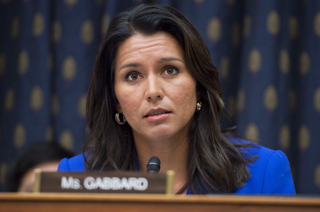 UNITED STATES - OCTOBER 1: Rep. Tulsi Gabbard, D-Hawaii, attends a House Foreign Affairs Subcommittee on the Western Hemisphere hearing in Rayburn Building, October 1, 2014, on Marine Sgt. Andrew Tahmooressi who is imprisoned in Mexico. Tahmooressi, who suffers from PTSD, has been held in Mexico since being arrested in March for carrying guns across the border. (Photo By Tom Williams/CQ Roll Call)