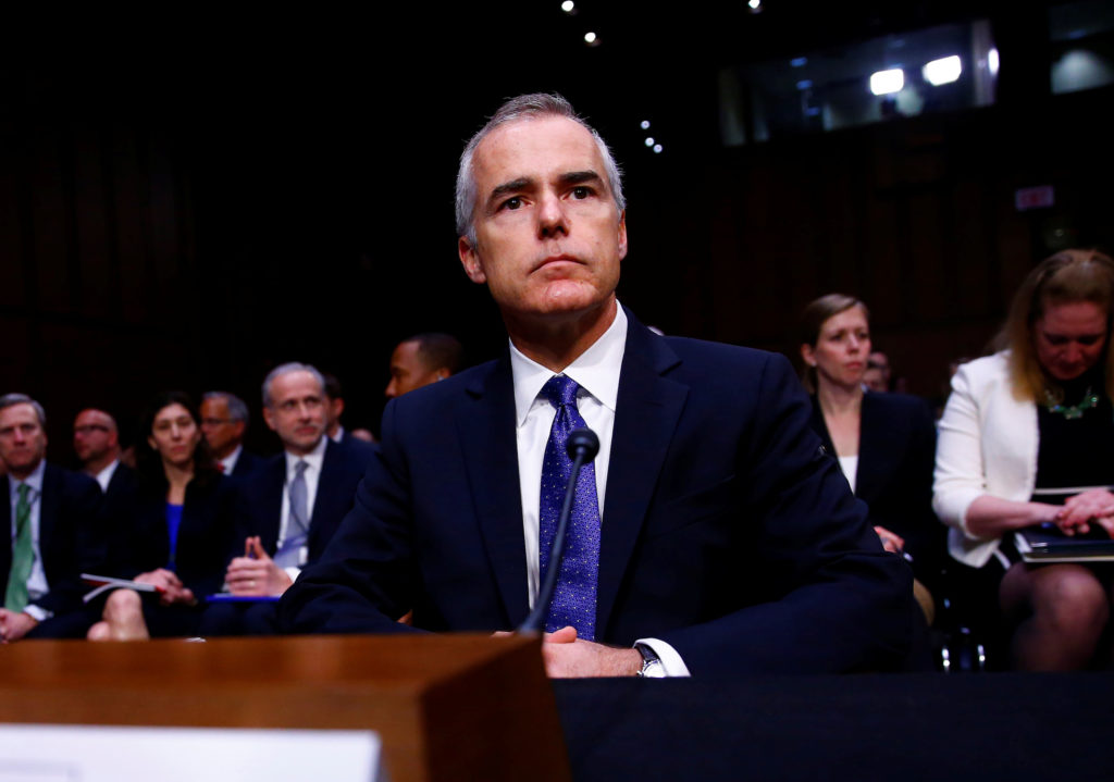 Acting FBI Director Andrew McCabe waits to testify before the U.S. Senate Select Committee on Intelligence on Capitol Hill...