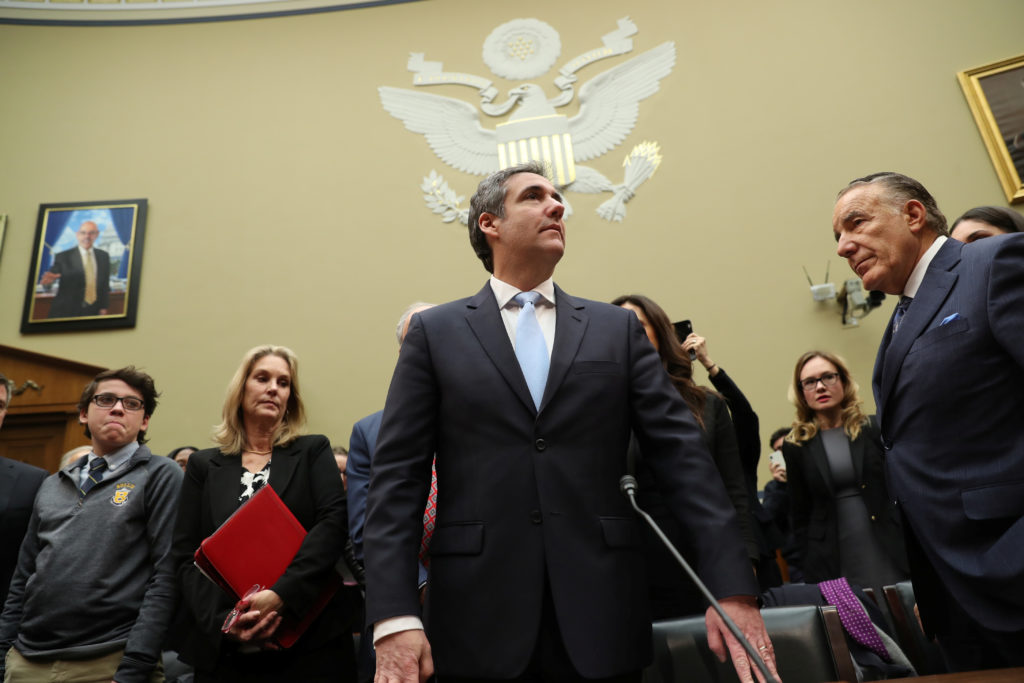 Michael Cohen, the former personal attorney of U.S. President Donald Trump, arrives at the witness table to testify before a House Committee on Oversight and Reform hearing on Capitol Hill in Washington, U.S., February 27, 2019. Photo by Jonathan Ernst/Reuters