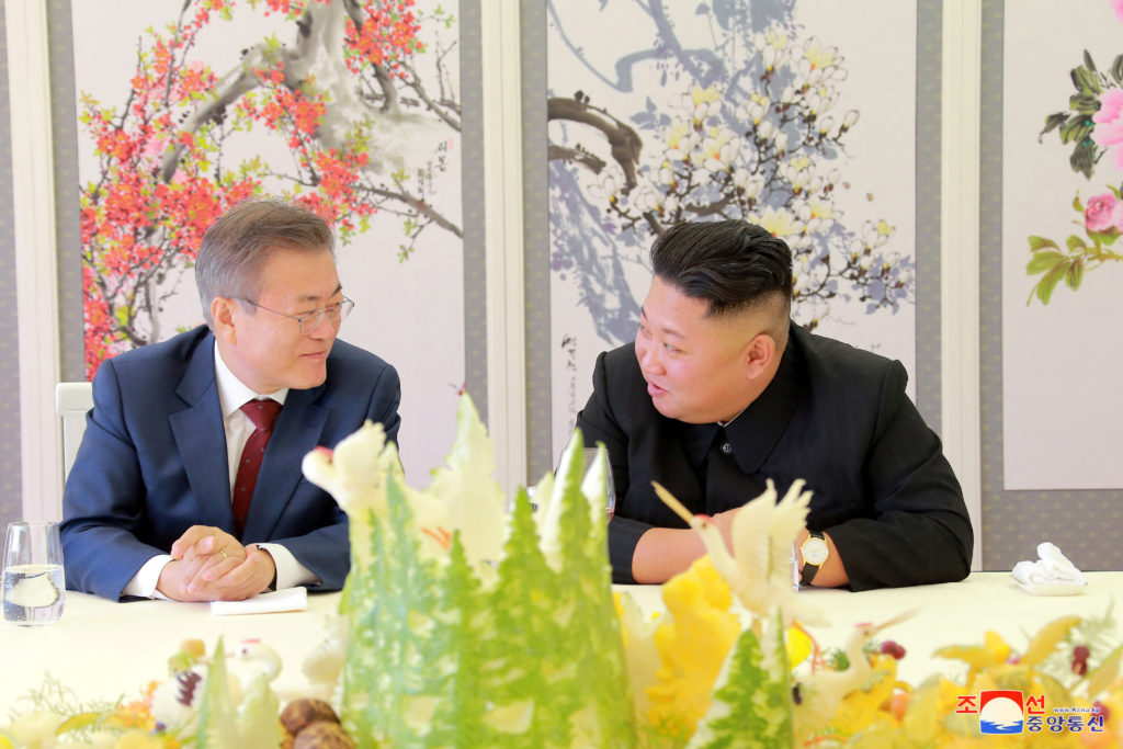 South Korean President Moon Jae-in speaks to North Korean leader Kim Jong Un during a luncheon, in this photo released by North Korea's Korean Central News Agency (KCNA) on September 21, 2018. At the meeting, Kim agreed to consider closing a 5-megawatt reactor at Yongbyon. Photo from KCNA via Reuters