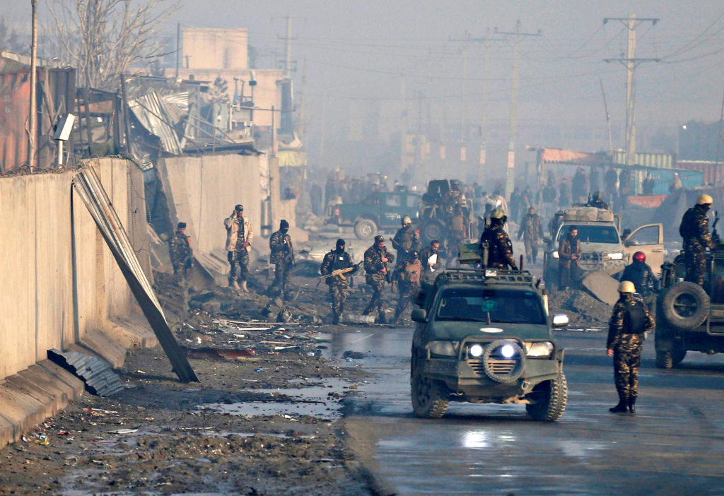 In this Jan. 15, 2019 file photo, Afghan security forces gather at the site a day after an attack in Kabul, Afghanistan. U.S. envoy to Afghanistan Zalmay Khalilzad is eager to strike a peace deal with the Taliban that would end America's longest war, but he faces several obstacles. Afghanistan has been mired in war for decades, and while the U.S. and the Taliban have both claimed significant progress in the latest talks, they have yet to pen a deal. Photo by Mohammad Ismail/Reuters