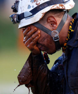A member of rescue team reacts, upon returning from the mission, after a tailings dam owned by Brazilian mining company Vale SA collapsed, in Brumadinho, Brazil January 27, 2019. Photo by Adriano Machado/Reuters