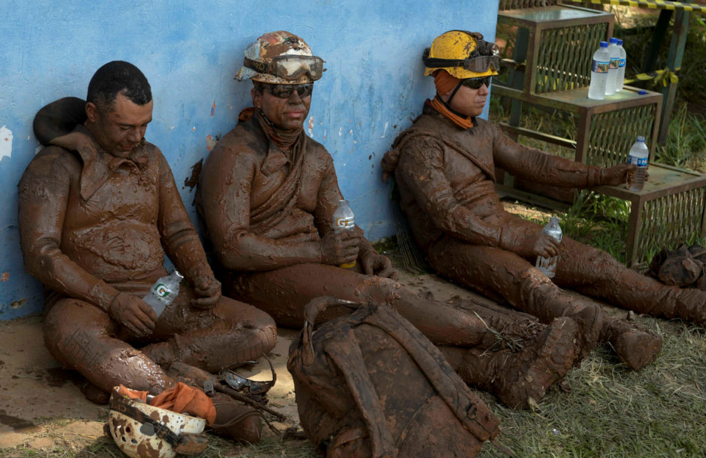 Members of a rescue team react upon returning from the mission, after a tailings dam owned by Brazilian mining company Vale SA collapsed, in Brumadinho, Brazil January 28, 2019. Photo by Washington Alves/Reuters