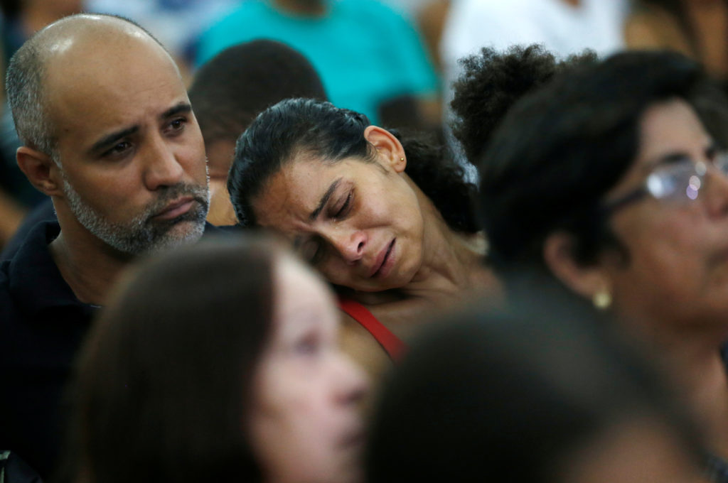 Relatives and friends of victims of a collapsed tailings dam owned by Brazilian mining company Vale SA, pay their respects during a mass in Brumadinho, Brazil January 31, 2019. Photo by Adriano Machado/Reuters