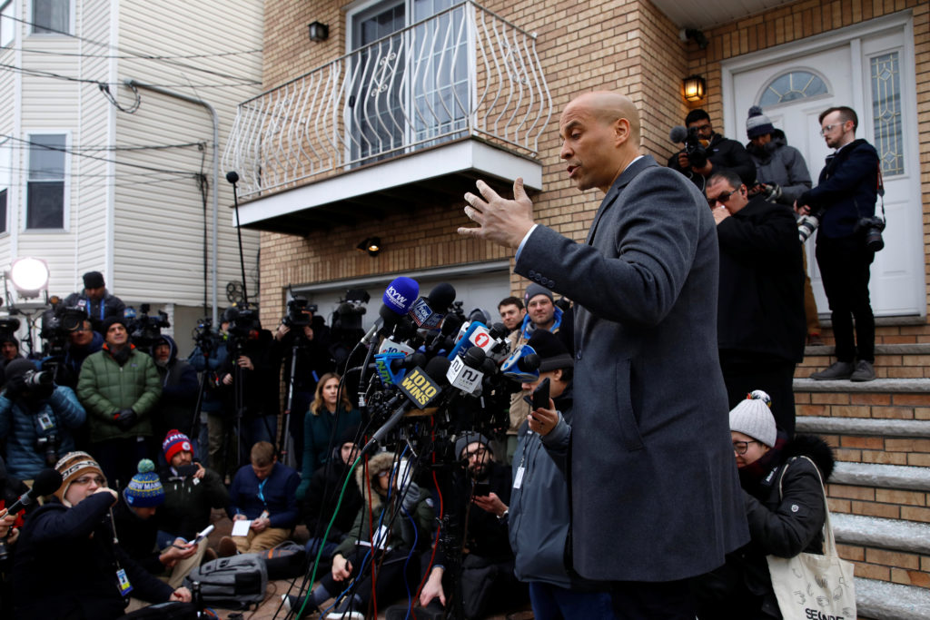 U.S. Senator Cory Booker (D-NJ) speaks to the media outside his home after announcing he will run for president in Newark,...