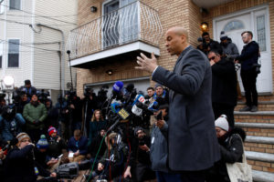 U.S. Senator Cory Booker (D-NJ) speaks to the media outside his home after announcing he will run for president in Newark, New Jersey, U.S., February 1, 2019. REUTERS/Andrew Kelly - RC16571830C0