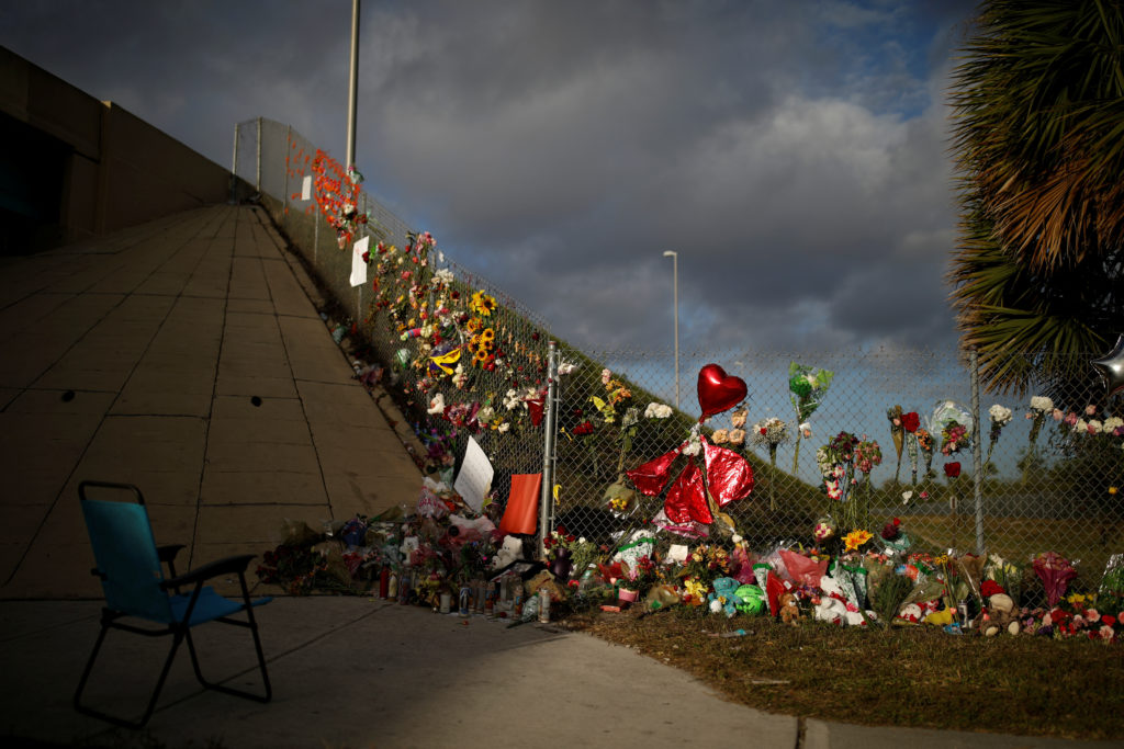 An empty chair is seen in front of flowers and mementoes placed on a fence to commemorate the victims of the mass shooting at Marjory Stoneman Douglas High School, in Parkland, Florida, U.S., February 20, 2018. REUTERS/Carlos Garcia RawlinsAn empty chair is seen in front of flowers and mementoes placed on a fence to commemorate the victims of the mass shooting at Marjory Stoneman Douglas High School, in Parkland, Florida, U.S., February 20, 2018. REUTERS/Carlos Garcia Rawlins