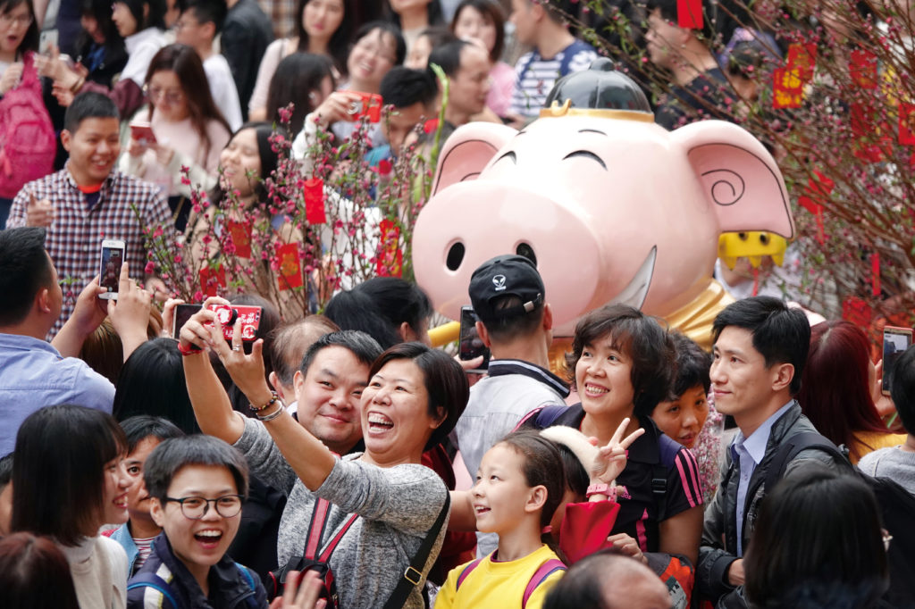 Visitors take pictures of an installation at a flower fair ahead of the Chinese Lunar New Year of the Pig, in Guangzhou, Guangdong province, China. Photo via Reuters