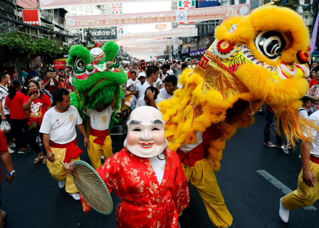 People perform Chinese Lion dance in Chinatown during the Chinese Lunar New Year in Bangkok, Thailand. Photo by Soe Zeya Tun/Retuers