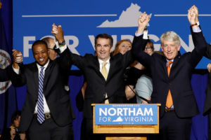 Virginia Governor Elect Ralph Northam (C) celebrates with Lt. Governor Elect Justin Fairfax and Attorney General Mark Herring at his election night rally on the campus of George Mason University in Fairfax, Virginia, November 7, 2017. Picture taken November 7, 2017. REUTERS/Aaron P. Bernstein - RC1EE26B6DD0