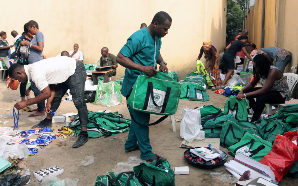 Staff arrange voting kits at South-South Zonal Store of INEC at Port Harcourt in Rivers State, ahead of the country's presidential election, in Port Harcourt, Nigeria February 15, Photo by Tife Owolabi/Reuters