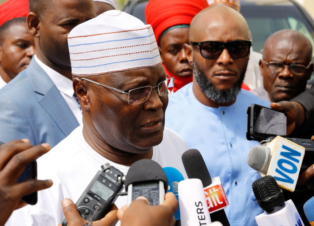 Nigeria's main opposition party presidential candidate Atiku Abubakar speaks to reporters, after the postponement of the presidential election in Yola, in Adamawa State, Nigeria February 16, 2019. Photo by Nyancho NwaNri/Reuters