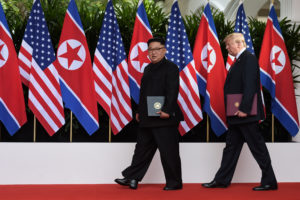 FILE PHOTO: U.S. President Donald Trump and North Korea's leader Kim Jong Un walk during their summit at the Capella Hotel on Sentosa island in Singapore June 12, 2018. Anthony Wallace/Pool via Reuters