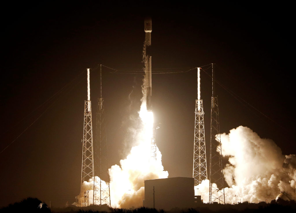 A SpaceX Falcon 9 rocket carrying Israel's first spacecraft designed to land on the moon lifts off on the first privately-...
