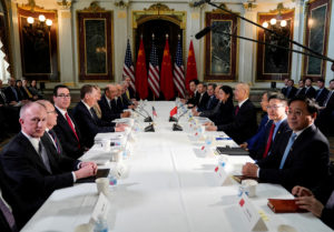 U.S. Trade Representative Robert Lighthizer, Treasury Secretary Steven Mnuchin, Commerce Secretary Wilbur Ross, White House economic adviser Larry Kudlow and White House trade adviser Peter Navarro pose for a photograph with China's Vice Premier Liu He, Chinese vice ministers and senior officials before the start of U.S.-China trade talks at the White House on February 21, 2019. Photo by Joshua Roberts/Reuters