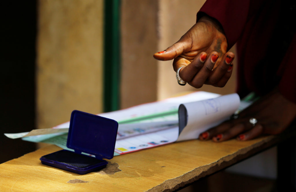 A woman casts her vote during Nigeria's presidential election at a polling station in Kazaure, Jigawa State, Nigeria, February 23, 2019. Photo by Afolabi Sotunde/Reuters