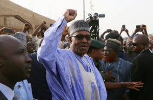 Nigerian President Muhammadu Buhari gestures as he arrives to cast a vote in Nigeria's presidential election at a polling station in Daura, Katsina State, Nigeria on February 23, 2019. Photo by Afolabi Sotunde/Reuters