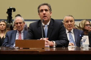 Michael Cohen, the former personal attorney of U.S. President Donald Trump, is flanked by his attorneys Lanny Davis (left) and Mike Monico (right) as he testifies before a House Committee on Oversight and Reform hearing on Capitol Hill on February 27, 2019. Photo by Jonathan Ernst/Reuters
