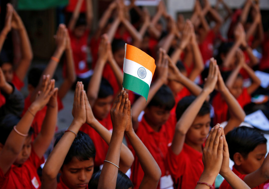 School children offer prayers for the release of an Indian Air Force pilot after he was captured by Pakistan, inside a sch...