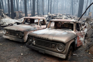 Trucks destroyed by the Camp Fire are seen in Paradise, California, U.S., November 14, 2018. Photo by REUTERS/Terray Sylvester