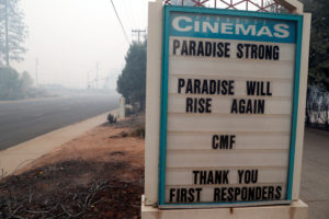 A sign is seen outside of Paradise Cinemas in the aftermath of the Camp Fire in Paradise, California, U.S., November 14, 2018. Photo by REUTERS/Terray Sylvester