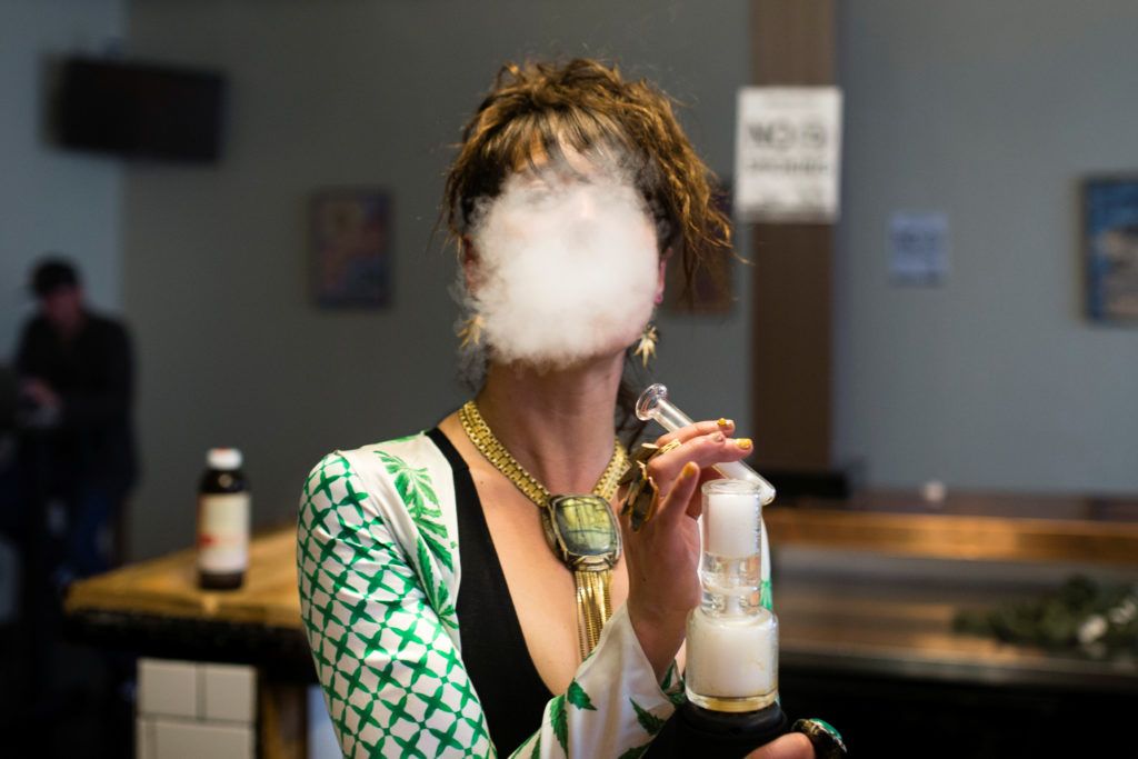 Elise McRoberts exhales after using a full spectrum oil vaporizer at the new Magnolia cannabis vape lounge in Oakland, California, U.S. April 20, 2018. Friday marked the first '4/20' since the sale of recreational marijuana became legal on January 1. Photo by REUTERS/Elijah Nouvelage