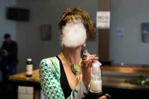 Elise McRoberts exhales after using a full spectrum oil vaporizer at the new Magnolia cannabis vape lounge in Oakland, California, U.S. April 20, 2018. Photo by REUTERS/Elijah Nouvelage