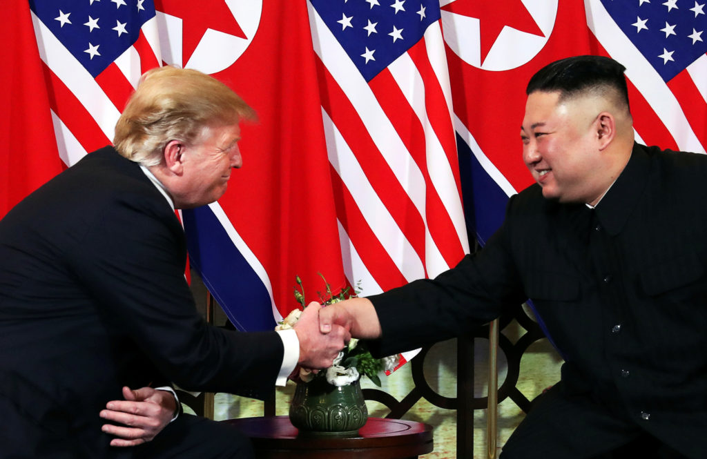 FILE PHOTO: U.S. President Donald Trump and North Korean leader Kim Jong Un shake hands before their one-on-one chat during the second U.S.-North Korea summit at the Metropole Hotel in Hanoi, Vietnam February 27, 2019. Photo by Leah Millis/Reuters