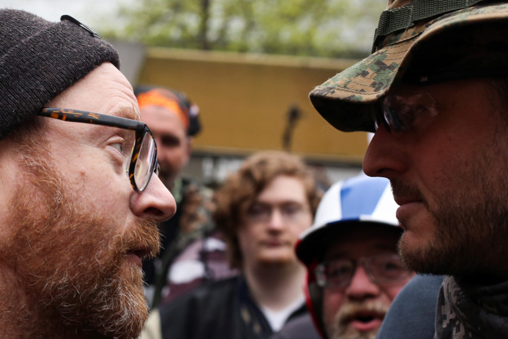 A protestor (right) from the Stand Against Communism rally, an event organized to oppose to anti-fascist demonstrations and to support U.S. President Donald Trump, among other causes, argues with a counter-protestor (left) during May Day events in Seattle, Washington, U.S. May 1, 2017.  Photo by REUTERS/David Ryder