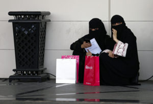 Saudi student are seen at the exhibition to guide job seekers to the Glowork Women's Career Fair, in Riyadh, Saudi Arabia October 2, 2018. The Saudi government app Absher is used to pay traffic fines, but it also allows men to grant or deny a woman permission to travel. Photo by Faisal Al Nasser/Reuters.
