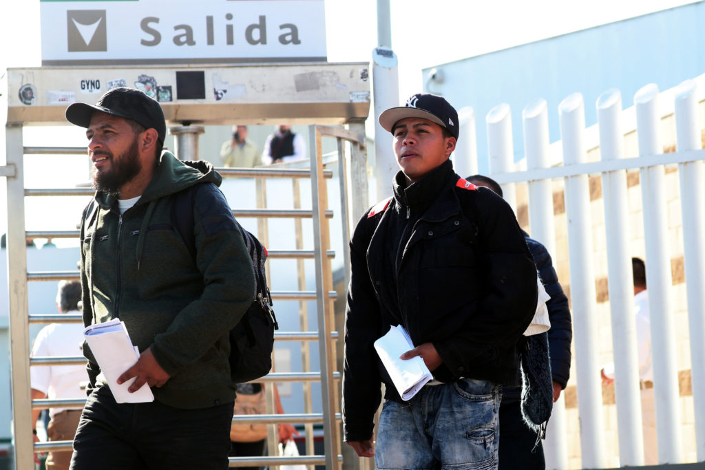 Central American asylum seekers exit the Chaparral border crossing gate after being sent back to Mexico by the U.S. in Tij...