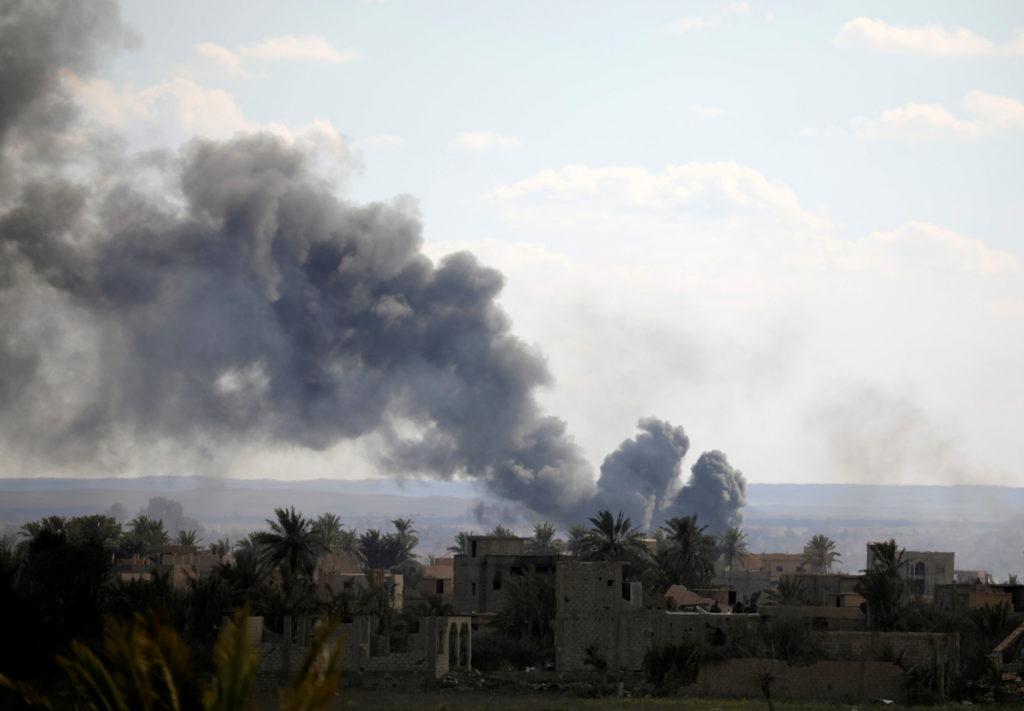 Black plumes of smoke rise in Baghouz, Deir Al Zor province, Syria …