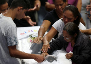 Family of Claiton Antonio Ribeiro, one of the victims killed in a shooting at Raul Brasil School, attends the collective funeral in Suzano, Brazil March 14, 2019. Photo by Amanda Perobelli/Reuters