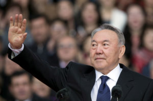 Kazakhstan's President and presidential candidate Nursultan Nazarbayev waves to audience during a 2015 election campaign rally at a stadium in Almaty, Kazakhstan. Photo by Shamil Zhumatov/Reuters