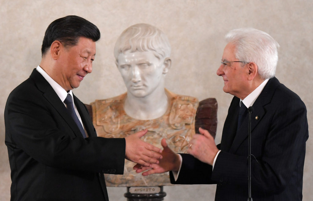 Chinese President Xi Jinping and Italian President Sergio Mattarella shake hands after addressing a forum of businessmen, at the Quirinal Palace, in Rome, Italy, on March 22, 2019. Photo by Tiziana Fabi/Pool via Reuters
