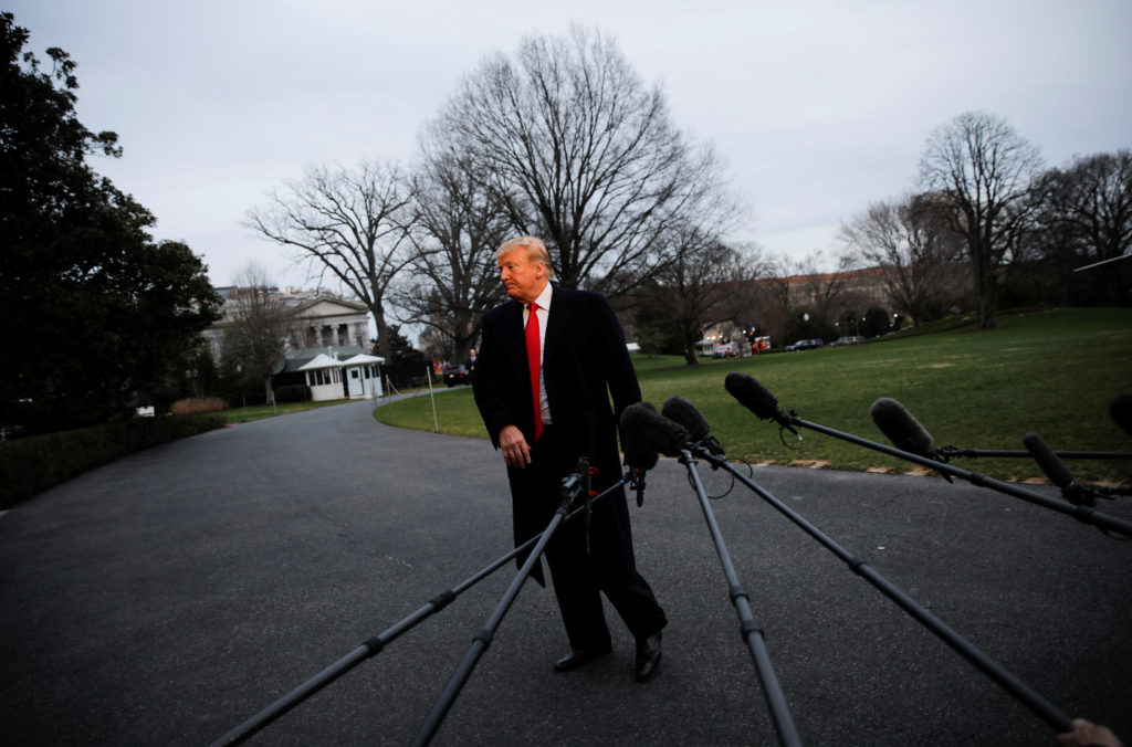 President Donald Trump walks away from talking to reporters about t…