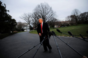 President Donald Trump walks away from talking to reporters about the report of Special Counsel Robert Mueller as he returns from a weekend in Florida at the White House in Washington, D.C. Photo by Carlos Barria/Reuters