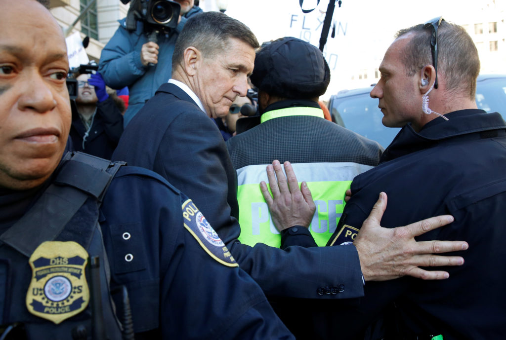 Former U.S. national security adviser Michael Flynn is surrounded by police officers as he departs after his sentencing was delayed at U.S. District Court in Washington, December 18, 2018. Photo by Joshua Roberts/Reuters