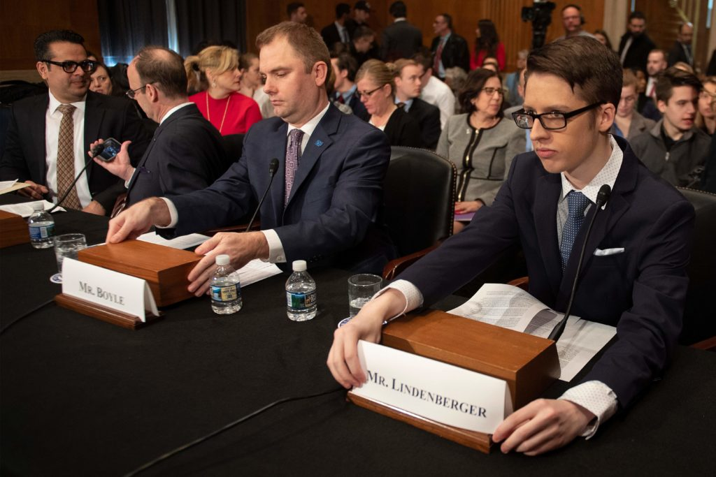Ethan Lindenberger (R), student at Norwalk High School in Norwalk, Ohio, who confided in a now-viral Reddit post that he had not been fully vaccinated due to his mother's belief that vaccines are dangerous, speaks before the Senate Committee on Health, Education, Labor and Pensions on Capitol Hill in Washington, D.C. Photo by Jim Watson/AFP/Getty Images